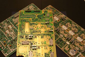 three gold and green circuit boards