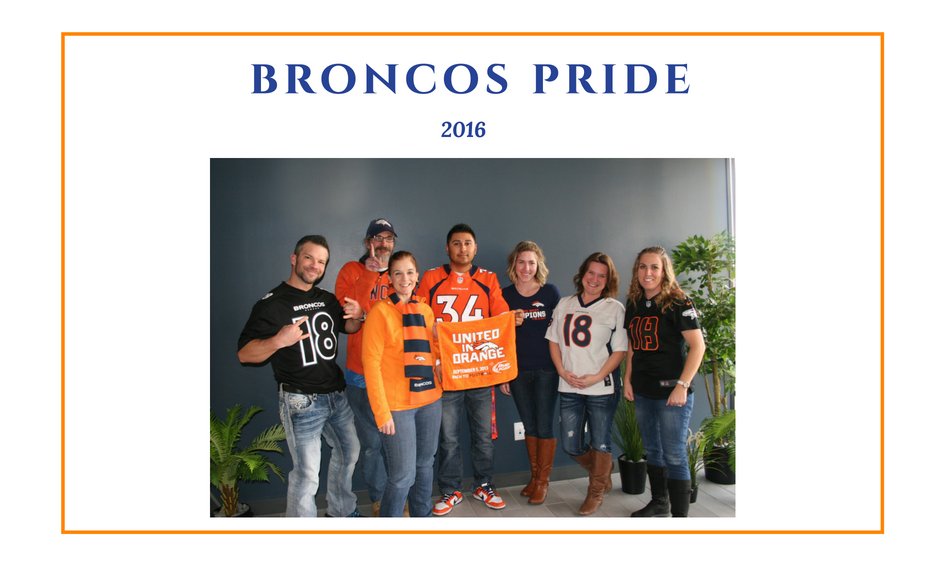 Advanced Assembly employees wearing Denver Broncos jerseys
