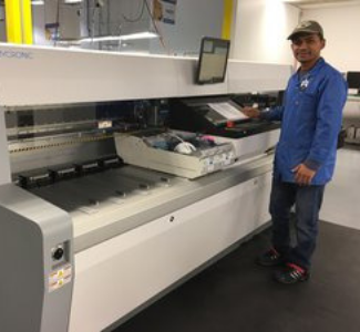 Advanced Assembly employee at the My300 machine